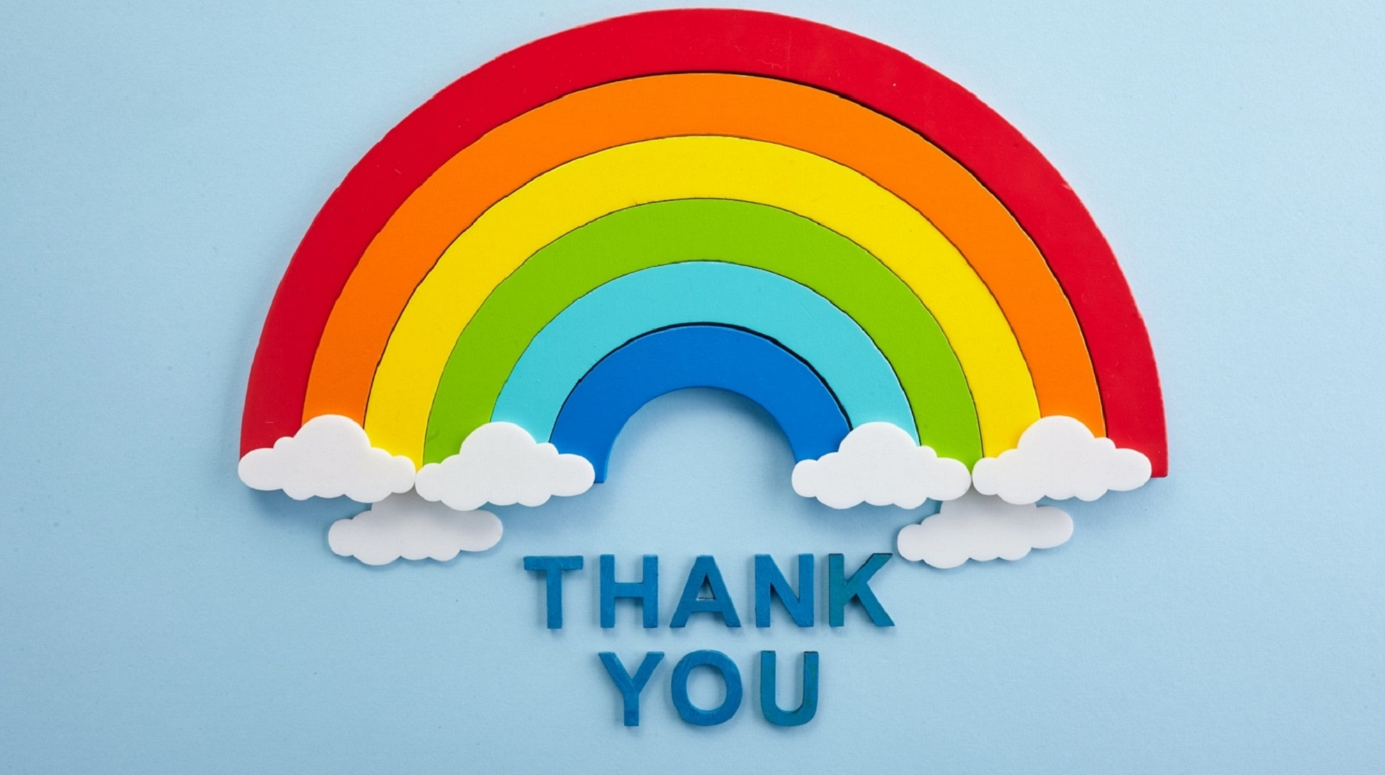 Rainbow over the words thank you